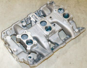 Tri-Power induction remains quite popular with Pontiac hobbyists. Finding an original 1965–1966 cast-iron intake manifold for use with later-model cylinder headers or aftermarket aluminum offerings can be somewhat difficult and costly. This cast-aluminum unit is a high-quality reproduction of the 1966 Pontiac Tri-Power manifold, which includes the larger center carburetor. It is sold through a few different sources, including Performance Years.